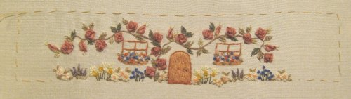 The house wall design for the 'Rose Cottage' pincushion by Carolyn Pearce