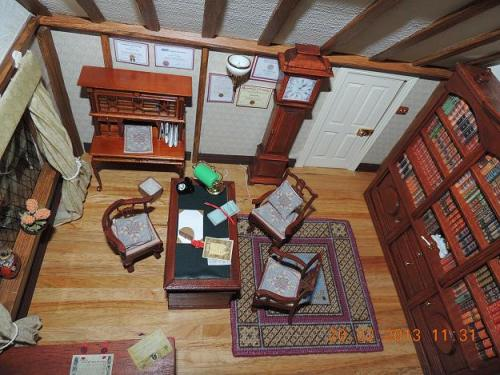 A doll's house scale solicitor's office - the carpet is called 'Isobel', and is one of the kits I produce. Margaret adapted the design to make her own cushions and chair seats.