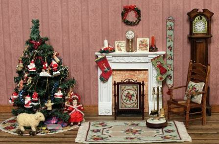 A doll's house room setting showing Christmas items and other miniature needlepoint, available as kits from www.janetgranger.co.uk